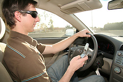 Dec. 13, 2011 - The National Transportation Safety Board called Tuesday for a nationwide ban on the use of cell phones and text messaging devices while driving. The recommendation if adopted by states, would outlaw non-emergency phone calls and texting by operators of every vehicle on the road. PICTURED: Jan 22, 2007 - Los Angeles, CA, USA -  A driver uses his cell phone while driving (Credit Image: © Camilla Zenz/ZUMAPRESS.com)