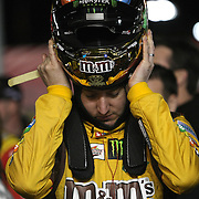NASCAR Sprint Cup driver Kyle Busch (18) is seen prior to the NASCAR Sprint Unlimited Race at Daytona International Speedway on Saturday, February 16, 2013 in Daytona Beach, Florida.  (AP Photo/Alex Menendez)