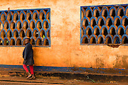 A boy walks past classroom windows outside the Bazzama primary school in the town of Bazzama, Cameroon on Wednesday September 16, 2009.  The school integrates the children of refugees from Central African Republic with residents from the area.