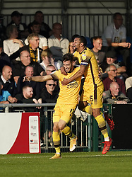 Sutton United's Will Randall (left) celebrates with Craig Eastmond after scoring his side third goal of the game during the Sky Bet League Two match at Borough Sports Ground, Sutton. Picture date: Saturday October 9, 2021.
