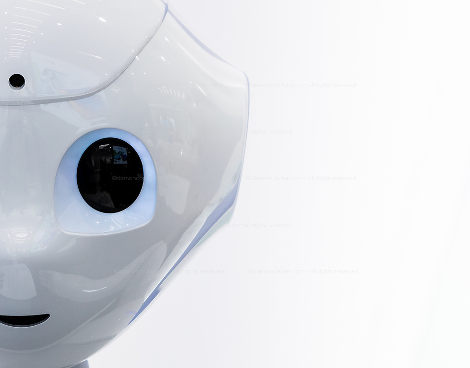 Half face portrait of Softbank's emotional consumer Robot, Pepper on display at the Softbank Store Omotesando, Tokyo, Japan. Friday August 1st 2014.  At the end of June 2021 the Softbank company announced it was cutting jobs in its global robotics business and had stopped production of the Pepper robot.