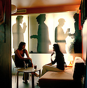 Locals enjoying a drink in a downtown bar in Warsaw, Poland