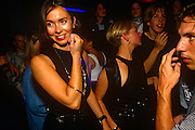 Beautifil woman is watched by unknown male in club in London's West End during a Bhangra music night