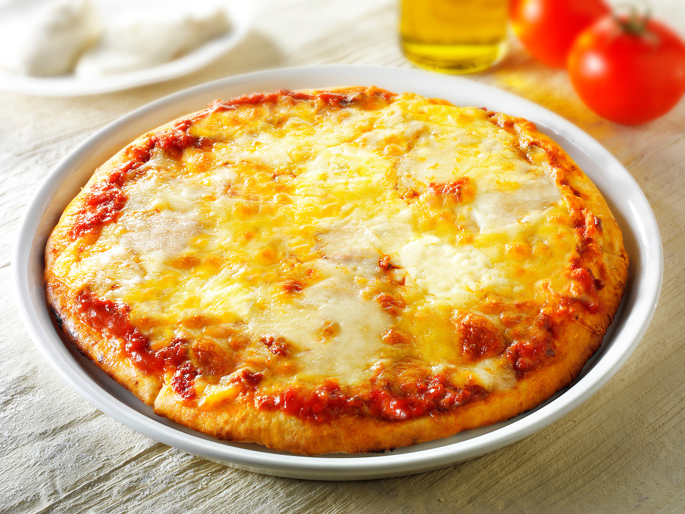 Pizza topped with  3 cheeses. A Margarita Neopolitan Pizza photos. Funky Stock pizzas photos