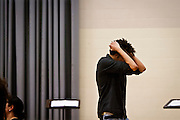 An individual  holds his head in mourning during the funeral for Tony Robinson, Jr. at Madison East High School in Madison, Wisconsin, Saturday, March 14, 2015. Hundreds of people gathered on Saturday for the funeral of a 19-year-old man killed by a police officer in Wisconsin's capital on March 6, a shooting that prompted protests over law enforcement's treatment of minorities.  REUTERS/Ben Brewer (UNITED STATES)