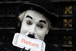 """Charlie Chaplin holds a 'Return"""" ticket in his mouth, seeking the UK's return to the EU fold. London, January 15 2019."""