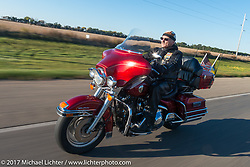 SD Patriot Guard Rider Randy Ward of Sioux Falls, SD (US Army) riding his 1998 Harley-Davidson Ultra on the USS South Dakota submarine flag relay across South Dakota. Groton, SD. USA. Sunday October 8, 2017. Photography ©2017 Michael Lichter.