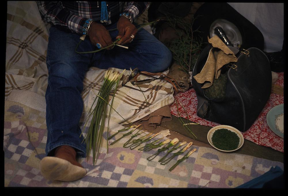 Medicine man Sam Begay readies the strips of yucca that will be used in Paul Keams Blackening Way.  Greasewood, AZ   1993
