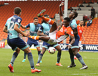 Blackpool's Armand Gnanduillet tries a spectacular overhead kick marked by Wycombe Wanderers' Aaron Pierre<br /> <br /> Photographer Stephen White/CameraSport<br /> <br /> Football - The EFL Sky Bet League Two - Blackpool v Wycombe Wanderers - Saturday 20 August 2016 - Bloomfield Road - Blackpool<br /> <br /> World Copyright © 2016 CameraSport. All rights reserved. 43 Linden Ave. Countesthorpe. Leicester. England. LE8 5PG - Tel: +44 (0) 116 277 4147 - admin@camerasport.com - www.camerasport.com