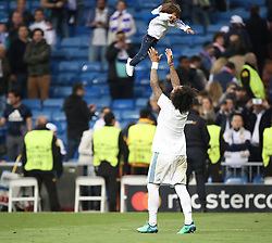 May 1, 2018 - Madrid, Spain - Marcelo of Real Madrid lifts his child into the air to celebrate victory after the UEFA Champions League Semi Final Second Leg match between Real Madrid and Bayern Muenchen at the Bernabeu on May 1, 2018 in Madrid, Spain. (Credit Image: © Raddad Jebarah/NurPhoto via ZUMA Press)
