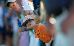 February 28, 2019 - Palm Beach Gardens, Florida, U.S. - Zachary Balfour, 8, Boca Raton, watches his favorite player Rickie Fowler tee off on the 15th hole during the first round of the Honda Classic Thursday at PGA National Resort and Spa in Palm Beach Gardens, February 28, 2019. (Credit Image: © Allen Eyestone/The Palm Beach Post via ZUMA Wire)