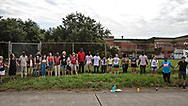 Rally for Healthy  Neighborhoods: A Vision For the Future, held by residents of Gordon Plaza and their supporters. They demand a fully funded relocation from their homes built on top of the Agriculture Street Landfill Site, on land the city sold them. The protesters hold hands in front of the Moton Elementary School, which is also built on toxic land over the Agricultural Street Landfill.