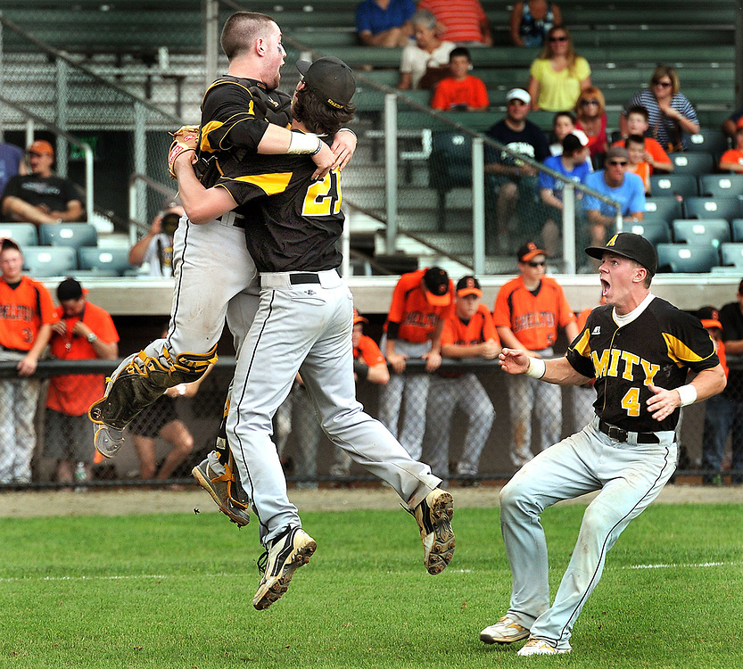 SCC Baseball championship, Yale Field, Amity 2- Shelton 1. Celebration after the win Amity catcher Paul Gusmano left, closing pitcher Sam Nepiarsky in an embrace, and Keith Klebart right. Mara Lavitt/New Haven Register<br /> <br /> 5/26/12