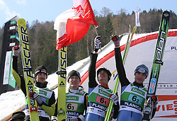 Polish team placed second: Adam Malysz, Stefan Hula, Kamil Stoch and Lukasz Rutkowski at Flying Hill Team in 3rd day of 32nd World Cup Competition of FIS World Cup Ski Jumping Final in Planica, Slovenia, on March 21, 2009. (Photo by Vid Ponikvar / Sportida)