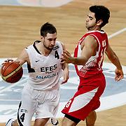 Efes Pilsen's Andrew WISNIEWSKI (L) during their Turkish Basketball league match Efes Pilsen between Erdemir at the Sinan Erdem  Arena in Istanbul Turkey on Saturday 29 January 2011. Photo by TURKPIX