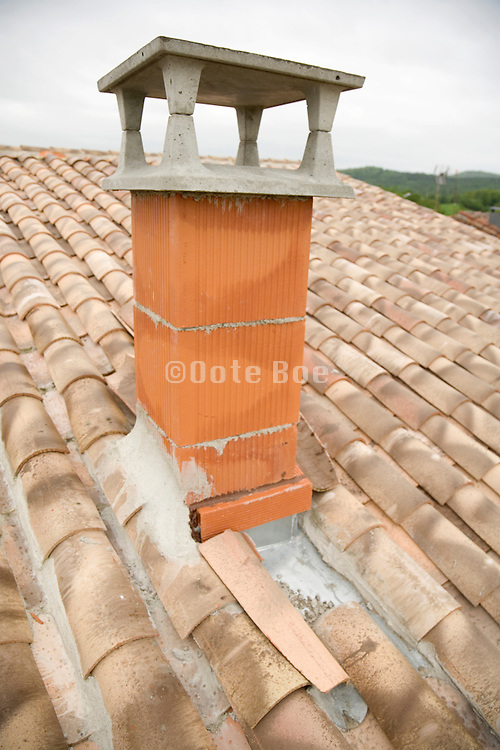unfinished chimney on a new roof South France