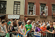 Spectators watch the 2011 Pride Parade in New York's West Village.