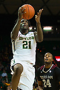 WACO, TX - DECEMBER 9: Taurean Prince #21 of the Baylor Bears drives to the basket against the Texas A&M Aggies on December 9, 2014 at the Ferrell Center in Waco, Texas.  (Photo by Cooper Neill/Getty Images) *** Local Caption *** Taurean Prince