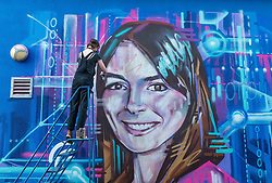 Edinburgh Science Festival, Edinburgh, Scotland, United Kingdom: <br /> Pictured: Graffiti and mural artist Shona Hardie puts the finishing touches to her portrait of Natalie Duffield, one of the artworks in a street art trail called 'Women in STEM' which showcases the achievements of nine women who have contributed to the world of Science, Technology, Engineering and Maths (STEM). Natalie Duffield is CEO of InTechnology SmartCitie, a company that provides free WiFi in central Edinburgh. Shona has also painted many of the other portraits in the trail which are displayed in venues across the city. <br /> The 2021 Edinburgh Science Festival runs from 26 June – 11 July.<br /> Sally Anderson   EdinburghElitemedia.co.uk