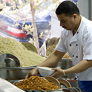 Koshary chef prepares food for the masses in Downtown Cairo. During the Egyptian revolution, he would frequently work till 3 am to keep Tahrir Square protesters fed.