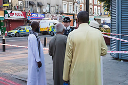 "Finsbury Park, London, June 19th 2017. A major police and emergency services operation with firearms officers in attendance is underway near Finsbury Park Mosque following reports of Several people being injured after a van struck a crowd of pedestrians near a north London mosque in what police have called a ""major incident"". Muslim residents speak to a police officer just yards from the scene."