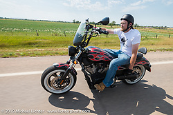 Ryan Hibbard riding to the Spur Creek Ranch on the annual Michael Lichter - Sugar Bear Ride hosted by Jay Allen with the Easyriders Saloon during the Sturgis Black Hills Motorcycle Rally. SD, USA. Sunday, August 3, 2014. Photography ©2014 Michael Lichter.
