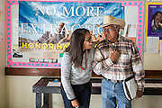 Navajo community leader Daniel Tso greets a fellow activist at a meeting at the chapter house in Counselor New Mexico where the Bureau of Land Management was hearing public comments on proposed new sites for leasing rights to additional drilling in the San Juan Basin.<br /> ((NOTE:The girl had recently been arrested at protest in Washington DC and declined to give her name))