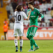 Besiktas's Olcay Sahan (L) and goalkeeper Tolga Zengin (R) during their Turkish Super League soccer match Antalyaspor between Besiktas at the Antalya stadium in Antalya Turkey on Monday 26 October 2015. Photo by Kurtulus YILMAZ/TURKPIX