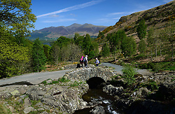 © Licensed to London News Pictures. 23/05/2015. Keswick, UK. Walkers make their way over Ashness Bridge near Keswick in the Lake District. Photo credit : Anna Gowthorpe/LNP