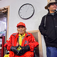 010414       Cable Hoover<br /> <br /> Codetalker Chester Nez waits with his grandson Latham Nez in the theater lobby during the WWI film festival at El Morro Theater Saturday.