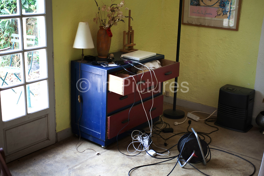 Scene inside a French country village house. This classical place with it's objects looks like a still life of French living. An overloaded power socket