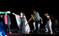Christine Anu and Mau Power perform as William Barton plays the didgeridoo during the Opening Ceremony for the 2018 Commonwealth Games at the Carrara Stadium in the Gold Coast, Australia.