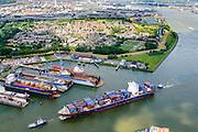 Nederland, Zuid-Holland, Rotterdam, 10-06-2015; Container schip CMA CGM Azure vaart de Eemhaven binnen, geassisteerd door twee sleepnoten van Fairplay, passeert de drijvende dokken van Damen Shiprepair Van Brink. In de achtergrond Pernis.<br /> Container ship entering Eem harbour being assisted by tugs.<br /> luchtfoto (toeslag op standard tarieven);<br /> aerial photo (additional fee required);<br /> copyright foto/photo Siebe Swart