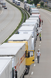 © Licensed to London News Pictures. 28/07/2015<br /> Operation stack lorries between J8 and J9 for Ashford on the M20.<br /> Operation stack is back on the M20 in Kent.<br /> Just days after Operation Stack was taken off the M20, it was brought back in the early hours of this morning.<br /> The authorities are blaming a heavy volume of traffic heading towards the Port of Dover and Eurotunnel and the continued disruption in Calais.<br /> The coast-bound carriageway between junctions 8 and 9 is closed to allow lorries to park, but the slip roads at junctions 9, 10 and 12 and 13 have also been shut. <br /> <br /> (Byline:Grant Falvey/LNP)