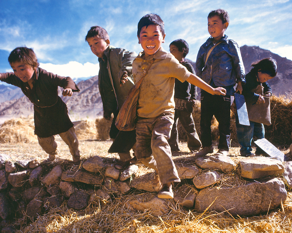Children celebrate the end of a school day, outside Leh, Ladakh, India.
