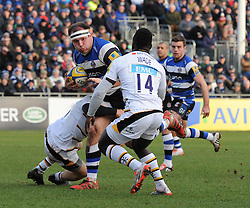 Bath Rugby tighthead prop Henry Thomas is tackled on Aviva Premiership clash against Wasps at the Recreation Ground - Photo mandatory by-line: Paul Knight/JMP - Mobile: 07966 386802 - 10/01/2015 - SPORT - Rugby - Bath - The Recreation Ground - Bath Rugby v Wasps - Aviva Premiership