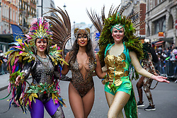 © Licensed to London News Pictures. 01/01/2020. London, UK. Performers from London School of Samba perform during the London New Year's Day Parade in central London. Over 10,000 performers representing the London boroughs and countries from across the globe are parading from Piccadilly Circus to Parliament Square as tens of thousands of Londoners and tourists line the route. Every year, dancers, acrobats, cheerleaders, marching bands, historic vehicles and more assemble in the heart of the capital for a colourful celebration of contemporary performances and traditional pomp and ceremony. Photo credit: Dinendra Haria/LNP