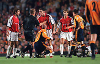 Martin Keown complains to referee Graham Poll after Gary McAllisters challenge on Arsenals Patrick Vieira (on ground). Arsenal 2:0 Liverpool, F.A.Carling Premiership, 21/8/2000. Credit : Colorsport / Stuart MacFarlane.