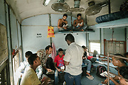 """Eating lunch in the """"disability"""" wagon. Inside the Dibrugarh-Kanyakumari Vivek Express, the longest train route in the Indian Subcontinent. It joins Kanyakumari, Tamil Nadu, which is the southernmost tip of mainland India to Dibrugarh in Assam province, near the border with Burma."""