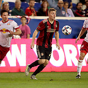 HARRISON, NEW JERSEY- OCTOBER 15: Julian Gressel #24 of Atlanta United challenged by Alex Muyl #19 of New York Red Bulls and Damien Perrinelle #55 of New York Red Bulls during the New York Red Bulls Vs Atlanta United FC, MLS regular season match at Red Bull Arena, Harrison, New Jersey on October 15, 2017 in Harrison, New Jersey. (Photo by Tim Clayton/Corbis via Getty Images)