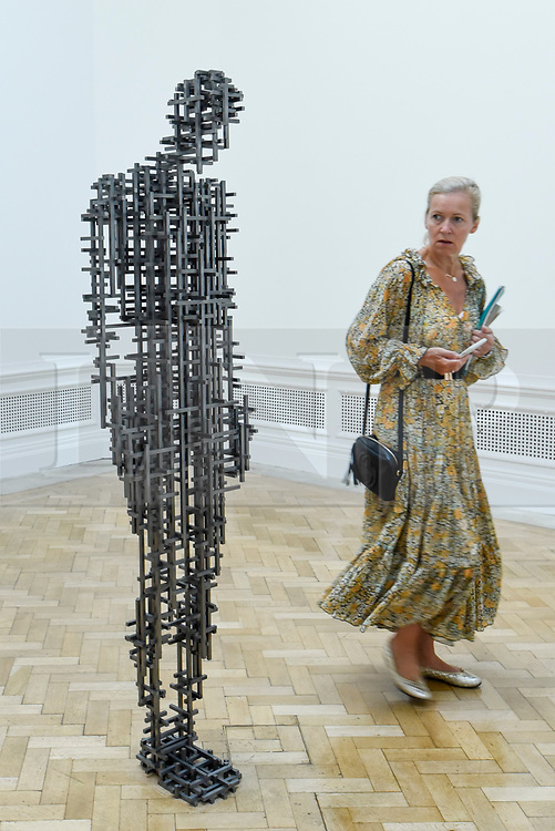 """© Licensed to London News Pictures. 17/09/2019. LONDON, UK. A visitor views """"Subject II"""", 2019, by Antony Gormley. Preview of a new exhibition by Antony Gormley at the Royal Academy of Arts.  The show bring together existing and specially conceived new works from drawing to sculptures to experimental environments to be displayed in all 13 rooms of the RA's Main Galleries 21 September to 3 December 2019.  Photo credit: Stephen Chung/LNP"""