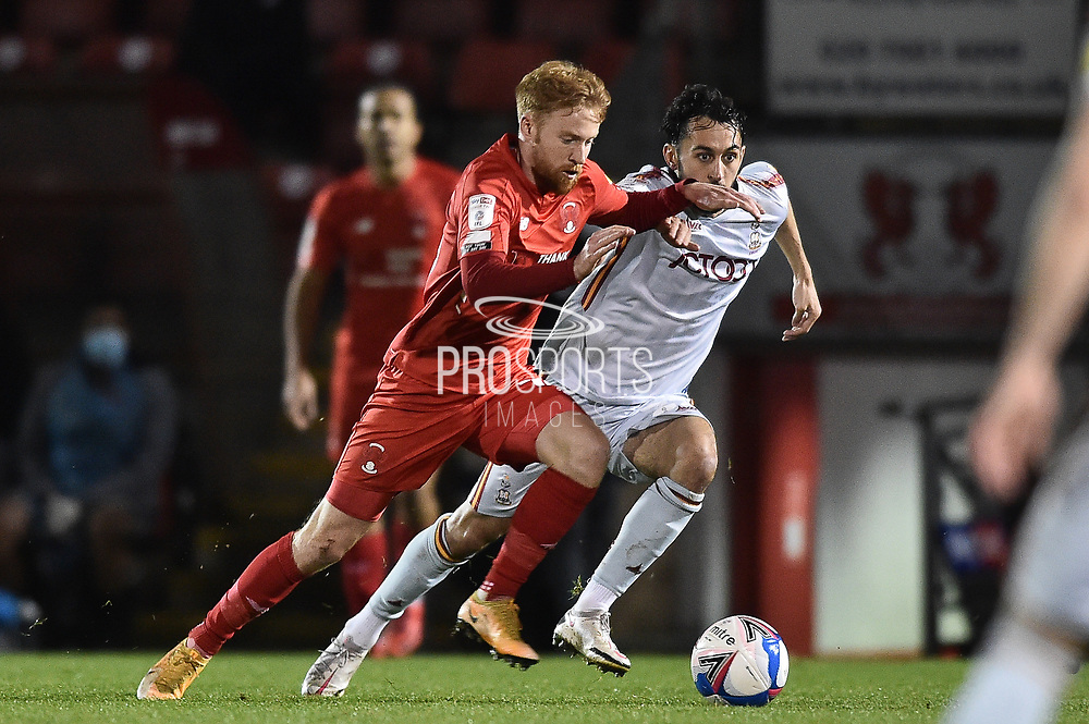 Leyton Orient's James Brophy(16) and Bradford City defender Nat Knight-Percival (22) battles for possession during the EFL Sky Bet League 2 match between Leyton Orient and Bradford City at the Breyer Group Stadium, London, England on 24 November 2020.