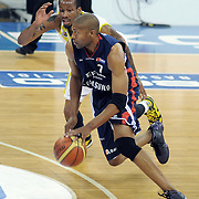 Fenerbahce Ulker's Tarence Anthony KINSEY (B) and Efes Pilsen's Charles SMITH (F) during their Turkish Basketball league Play Off Final third leg match Fenerbahce Ulker between Efes Pilsen at the Abdi Ipekci Arena in Istanbul Turkey on Tuesday 25 May 2010. Photo by TURKPIX