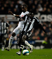 Photo: Jed Wee/Sportsbeat Images.<br /> Newcastle United v Tottenham Hotspur. The FA Barclays Premiership. 22/10/2007.<br /> <br /> Newcastle's Obafemi Martins (R) holds off Tottenham's Didier Zokora.