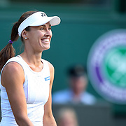 LONDON, ENGLAND - JULY 14: Martina Hingis of Switzerland shares a light hearted moment while playing  with Jamie Murray of Great Britain during the Mixed Doubles Semi Final on Center Court during the Wimbledon Lawn Tennis Championships at the All England Lawn Tennis and Croquet Club at Wimbledon on July 14, 2017 in London, England. (Photo by Tim Clayton/Corbis via Getty Images)