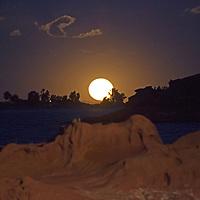 South America, Peru, Laka Titicaca. Super Moon rises over Lake Titicaca landscape.
