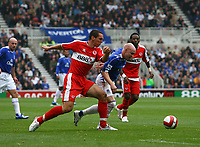 Photo: Andrew Unwin.<br />Middlesbrough v Everton. The Barclays Premiership. 14/10/2006.<br />Everton's Andy Johnson (R) looks to squeeze past Middlesbrough's Andrew Taylor.