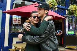 © Licensed to London News Pictures. 16/05/2021. London, UK. Two friends hug outside The Toll Gate - JD Wetherspoon's pub in north London, as hugging is allowed again, part of step three of the government's roadmap to ease the Covid-19 restrictions. Photo credit: Dinendra Haria/LNP