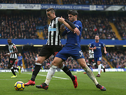 """Newcastle United's Javier Manquillo (left) and Chelsea's Alvaro Morata battle for the ball during the Premier League match at Stamford Bridge, London. PRESS ASSOCIATION Photo Picture date: Saturday December 2, 2017. See PA story SOCCER London. Photo credit should read: Steven Paston/PA Wire. RESTRICTIONS: EDITORIAL USE ONLY No use with unauthorised audio, video, data, fixture lists, club/league logos or """"live"""" services. Online in-match use limited to 75 images, no video emulation. No use in betting, games or single club/league/player publications."""