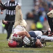 NEW HAVEN, CONNECTICUT - NOVEMBER 18: Jordan Carey #15 of Yale tackled by Alex White #38 of Harvard during the Yale V Harvard, Ivy League Football match at the Yale Bowl. Yale won the game 24-3 to win their first outright league title since 1980. The game was the 134th meeting between Harvard and Yale, a historic rivalry that dates back to 1875. New Haven, Connecticut. 18th November 2017. (Photo by Tim Clayton/Corbis via Getty Images)